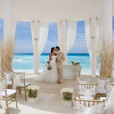 Beach wedding - Love the white and gold/sand colours