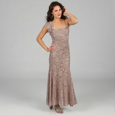 @Overstock - What a flattering silhouette, this gorgeous dress form Jump Apparel features a sweetheart bodice that is accented by a one shoulder flower ruffle. Adorned with lace and sequins, this dress will flatter your curves and create a glamorous look.http://www.overstock.com/Clothing-Shoes/Jump-Apparel-Juniors-Taupe-One-shoulder-Lace-and-Sequin-Dress/7713044/product.html?CID=214117 $139.99