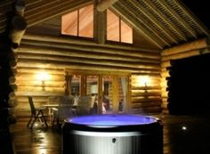 Log cabin with a hot tub