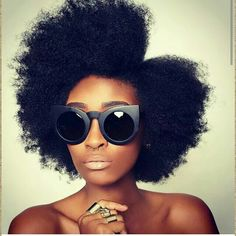 Natural hair + cat eye sunnies.