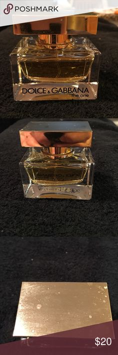 Dolce & Gabbana the one perfume Dolce & Gabbana the one perfume 30 ml/1 fl. oz worn the perfume a few times. Top has few marks on it as seen in pics. Dolce & Gabbana Other