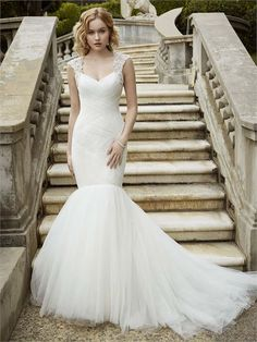 Ivalo from Blue By Enzoani is a dramatic mermaid dress with a tulle skirt and embellished straps