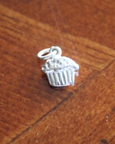 Cupcake charms make a sweet jewelry gift for a birthday girl, baker, tea party, or anyone who simply loves to eat cupcakes.  Sterling silver charm measures 10mm. Add a hand stamped necklace personalized with a name, birthdate, initial to make an extra sweet treat.
