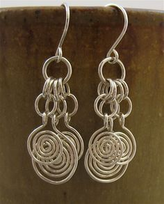 Items similar to Swirly Sterling Silver Wire Dangle Earrings, Wire Earrings, Silver Wire Jewelry, Silver Chainmaille Jewelry, Silver Chainmail Earrings on Etsy Wire Wrapped Earrings, Wire Earrings, Etsy Earrings, Earrings Handmade, Silver Earrings, Silver Ring, Gold Ring, 925 Silver, Metal Jewelry