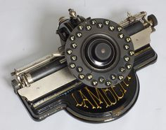 WANT - Lambert No. 1. Lambert Typewriter Co., New York, 1902.  ----- Auction est. $300-$500.  ----- The Lambert is a beautiful machine with a most unique design. Frank Lambert, a French immigrant, spent seventeen years developing his typewriter. The first patent was in 1884 and it came to market in 1896. The typewriter sold well in America and Europe for a number of years.