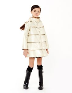 aw15: Since its debut in 2013, Oil & Water has become the go-to collection for chic rainwear. This season, buyers are responding to the Opera Coat in textured Bronzed White edged in gold. www.oilandwater.com (buyers' pick)