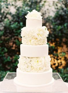 Beautiful wedding cake with alternating rows of cake and fresh flowers
