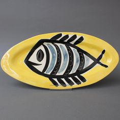Ceramic Decorative Platter with Fish Motif by Jacques Pouchain (circa Ceramic Decor, Pottery Studio, Yellow Background, Makers Mark, Platter, 1960s, Black And Grey, Fish, Ceramics