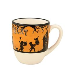 A bone-chilling night is just ahead and it's time for a warm cider or hot chocolate with lots of whip cream! This Trick Or Treat Mug will make all of your drinks spooky good! - Ceramic Halloween mug.