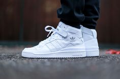 "adidas Originals Forum Mid ""Triple White"": There's only one descriptor that is fitting for the new adidas Originals Forum Mid drop and it's 'fresh.' This clean triple white colorway provides th. Sneaker Outfits, Converse Sneaker, Puma Sneaker, Sneaker Boots, Sneakers Mode, White Sneakers, Sneakers Fashion, Shoes Sneakers, Shoes Sandals"