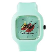 There's no place like home. Beautiful watch with Dorothy's ruby slipper and Emerald City from Wizard of Oz on a teal background. A great Christmas gift for a fan of this movie.