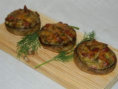 Reteta culinara Garnitura ciuperci umplute la cuptor din categoria Aperitive / Garnituri. Cum sa faci Garnitura ciuperci umplute la cuptor
