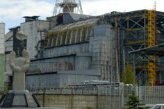 A close view of reactor number 4 of Chernobyl nuclear power plant in this May 10, 2007 picture, with the Chernobyl Monument, left, erected in 2006. (AP Photo/ Efrem Lukatsky)