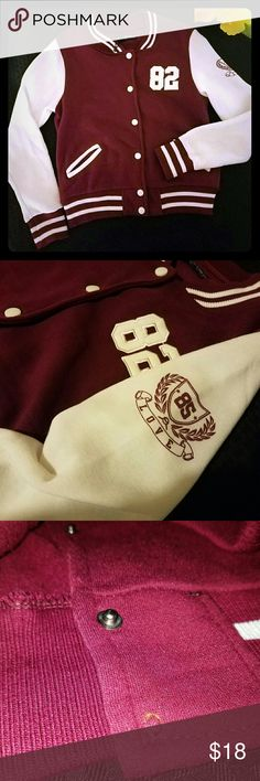 Varsity jacket 100% polyester  SuperNova sweater Burgundy/maroon and white 3rd picture reveals that it is missing a button Size large but runs small  Make me an offer - you never know what i might say yes too  SuperNova  Sweaters