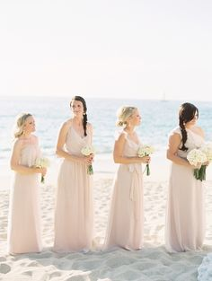 Love these blush pink bridesmaid's dresses from Bella Bridesmaid. See more of this destination wedding on Style Me Pretty: http://www.StyleMePretty.com/2014/03/07/destination-wedding-in-puerto-vallarta-mexico/ Photography: Clary Pfeiffer