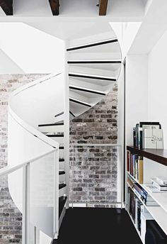 An all-white industrial-style home with minimalist charm in Sydney White Industrial, Industrial Style, Antique White Usa, Style Loft, White Brick Walls, Modern Staircase, Staircase Ideas, Spiral Staircases, Storey Homes