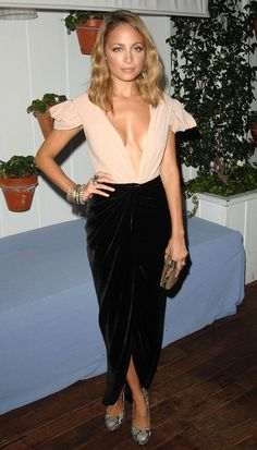 19. Nicole Richie shows off her style in a low-cut top at the Dujour party