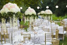 Golden chairs, round tables with lace tablecloths, and extravagant flower pieces. Creating a regal yet charming feel.