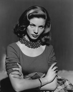 Lauren Bacall, with famous pout. http://media-cache-ec1.pinterest.com/550x/23/98/67/2398671f57ad931bfc4f06dd584e67a2.jpg