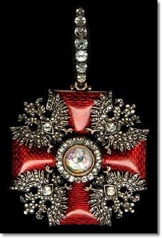 Russia, Order of St Alexander Nevsky circa 1837-39 A privately-made 'black' sash badge, in gold and enamels, unsigned and unmarked, circa 1837-39, in the form of a Maltese cross with dark red enamel gold-framed limbs of flat section, gold broad-winged Imperial eagles in angles, their wing tips almost touching, with central painted enamel portrait of St Alexander Nevsky on horseback right,