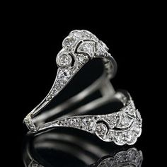Keeper Ring - Antique Jewelry University ---  In jewelry a keeper ring is a close fitting ring of simple design which is worn on the finger to prevent another - more valuable - ring from sliding off that finger. When the diamond ring became the popular love token in the mid-18th century, keeper rings were worn to protect the larger more costly diamond ring. As the diamond ring morphed into a betrothal ring (c.19th century) the keeper became more elaborate and evolved into the wedding band.
