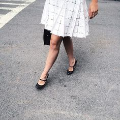 Camilla Daterre crosses the street in uptown New York City in Thom Browne womens skirt and shoes, as captured by Patrick Janelle.