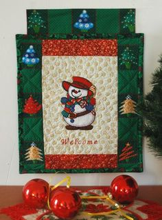 Advanced Embroidery Designs. Free Projects and Ideas. Christmas Welcome Sign with machine embroidery of a snowman.