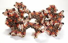 "Wrapped Up Crazy Bracelet/Necklace Tutorial by SturdyGirlDesigns Beadwork Magazine in 2008 and was called ""Crazy for Copper"""