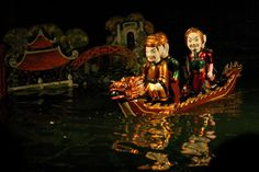 Hanoi Water Puppets - Legend of the restored sword King Le Loi on boat (image)