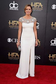 Kim Dickens chose a Lorena Sarbu dress, Jacob & Co. earrings and a Rauwolf clutch for the Hollywood Film Awards.