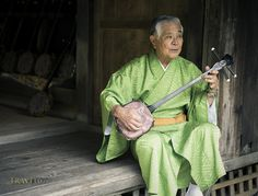 Okinawan man with sanshin by Travel 67, via Flickr
