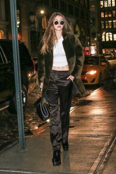 Gigi Hadid wearing Mansur Gavriel Lady Bag, Oliver Peoples The Row After Midnight Sunglasses and Sandro Kim Coat