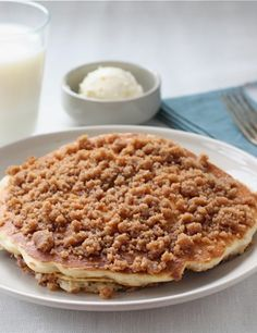 Cinnamon Streusel Pancakes Recipe on twopeasandtheirpod. The BEST pancakes you will ever eat!