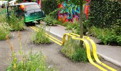 Yellow Street Lines Form a Park Bench Around a Tree in this Temporary Green Space by The Edible Bus Stop   Colossal