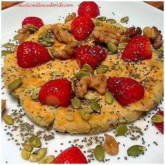 Breakfast pancake. Gluten, dairy and processed sugar free. Just coconut flour, buckwheat flour, eggs, filtered water, grated sweet potato and chia seeds. Topped with strawberries, raw activated walnuts and pumpkin seeds, chia seeds and one teaspoon of map
