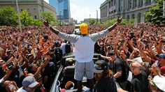 Cleveland Cavaliers star LeBron James stands in the back of a Rolls Royce as it…