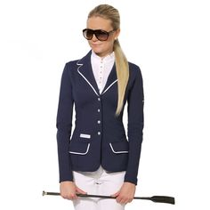Equestrian - Women's riding apparel developed into a high fashion.