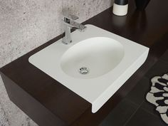 Corian® colour: Glacier White   Application: Vanity top with integrated 820 Corian bowl  Design by: Formed