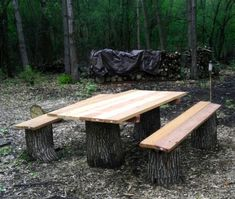 Rustic picnic table with large cut oak logs and planks of 2x8 cedar wood. The cedar will gray over time for a natural look - or stain and seal them for a more polished finish.