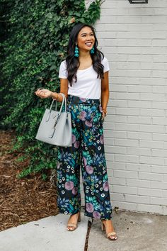277f6b5c8ff3 Blogger Hoang-Kim styles a pair of silk wide-leg pants with teal feather