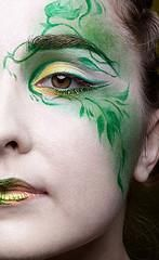 Green fairy makeup! I like the gold accents. The gold could be a medium for the green and black sides of the face! :D