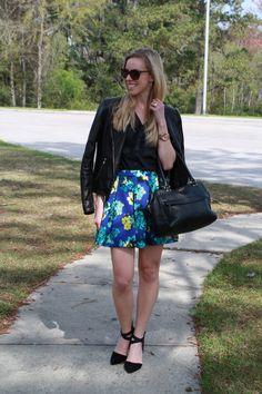 Wildflowers: cobalt blue floral skater skirt, black leather moto jacket, suede ankle strap pumps, Kate Spade bag