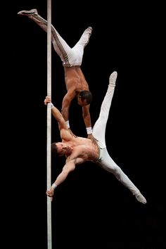Leosvel and Diosmani performing on the chinese pole.