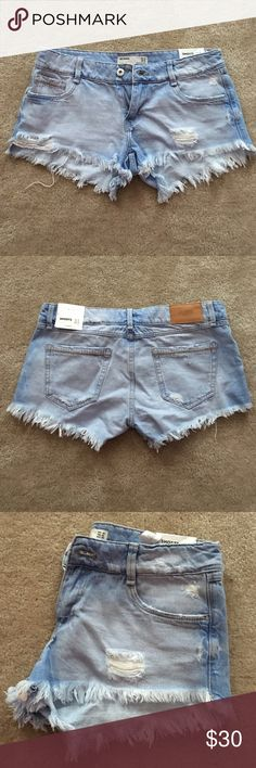 Zara denim shorts Distressed denim booty shorts by Zara. Runs small in my opinion. New Zara Shorts Jean Shorts