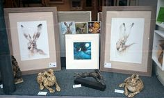 Picture House hare window, drawings by Nicky Litchfield & ceramic hares by Jan Lord