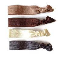 This package includes four of KC Elastic Ties signature hair ties.  KC Elastic Ties are made out of elastic that is soft and stretchy. They also double as chic bracelets when your hair doesn't need to be up.   KC Elastic Ties are handmade and are heat treated on the ends to prevent fraying.  ...