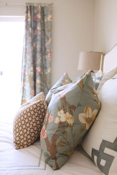 Idea: use a duvet in a great pattern to create window treatments and pillow covers. This one used a queen duvet for 2 panels + 2 pillow covers. Smart!