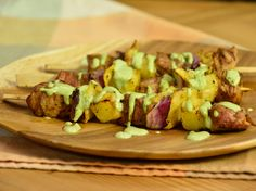 Tacobab al Pastor recipe from Marcela Valladolid via Food Network - Cubed Pork Tenderloin marinaded 1 hr. Fresh Pineapple, Red Onion, Corn Tortilla's with Cilantro Crema
