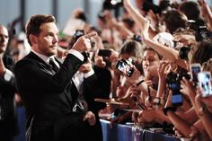 """Chris Pratt takes selfies with fans at the premiere of """"The Magnificent Seven' during the 73rd Venice Film Festival at Sala Grande on September 10, 2016 in Venice, Italy."""