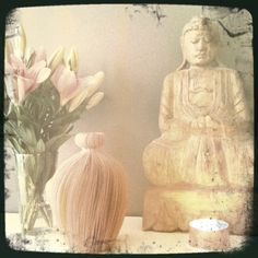 Buddha and vintage paper vase.   Fresh flowers and lighted candle every day. Buddha (Palma.no).